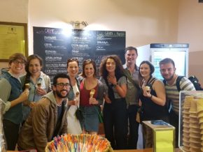 Group of tourists having artisanal gelato during our food tour in Bologna