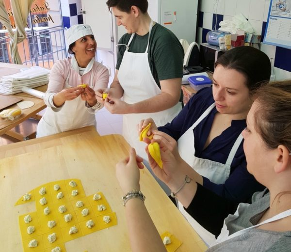 Making tortellini during our cooking course in Bologna