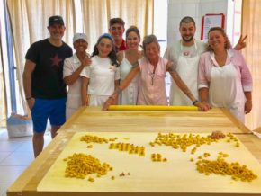 Family with ladies making pasta in Bologna
