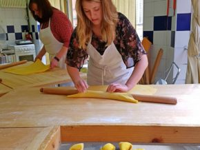 Rolling the dough and making tortelloni during the cooking class