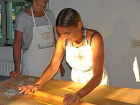 Rolling the dough during our cooking class in Dozza